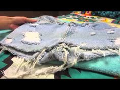 Hey guys!  This DIY is showing you how I cut holes in my jeans so that the white threads are still showing! I also show you how to stud jeans!  Check out this video on how I cut the shorts I used in this video: http://www.youtube.com/watch?v=_V2ALny3jV4   I used 1 cm gold studs for the front and back pockets!  Thanks for watching! I hope this he...