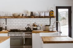 Rustic wood shelving with darker stained countertops