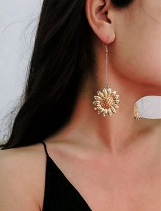 Description: Golden Sunflower Earrings - Feminine Charm Earrings - Flower Dangle Earrings Material: Alloy Weight: g / strip oz Processing: Plating Style: women's style Modeling: Flowers… Simple Earrings, Heart Earrings, Bridal Earrings, Bridal Jewelry, Coin Necklace, Leather Necklace, Beaded Necklace, Jewelry For Her, Cute Jewelry