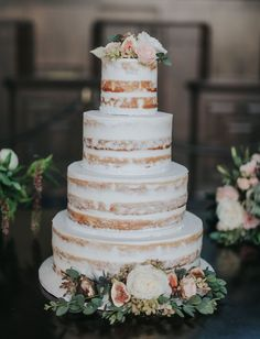 four-tiered naked cake with blush florals
