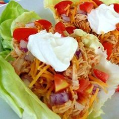 "Fiesta Slow Cooker Shredded Chicken Tacos | ""This was very flavorful. We used this to make lettuce 'tacos', and topped them w/ red onion, tomatoes, shredded cheddar and a bit of sour cream. The whole family LOVED this."""