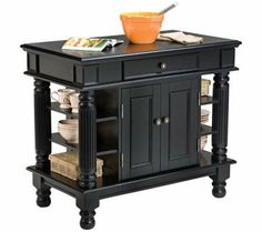 Home Styles Black Wood Base with Wood Top Kitchen Island x x at Lowe's. Home Styles Americana Kitchen island is constructed of solid hardwoods and engineered woods with a rich Black finish. Black Kitchen Island, Farmhouse Kitchen Island, Black Kitchen Cabinets, Black Kitchens, Home Kitchens, Kitchen Dining, Kitchen Islands, Kitchen Carts, Kitchen Storage