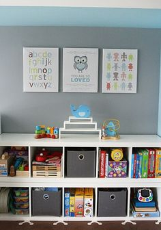 Good idea for organization for a toddler room. Bookshelves turned on their sides.