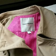 Isaac Mizrahi For Target Trench ☆☆MAKE OFFER☆☆ Beautiful tan trench coat w/belt by Isaac Mizrahi. Size medium. Pretty pink lining. I am 5'7 for length reference. This is big on me, I am a 34C. TWO THINGS TO NOTE: THERE ARE 2 SMALL SNAGS INSIDE THE LEFT ARMPIT. NOT HOLES!! THE EXTRA BUTTON ON THE INSIDE IS COMING LOOSE. Other than that, this coat is perfect. Kinda heavy and well made! Has multiple pockets in and out. No trades or paypal. Bundle for discounts. ☆☆REASONABLE OFFERS CONSIDERED☆☆…