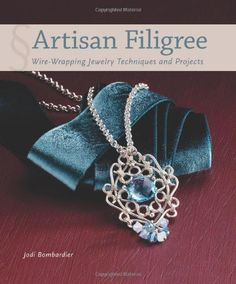 Artisan Filigree: Wire-Wrapping Jewelry Techniques and Projects by Jodi Bombardier http://www.amazon.com/dp/1596686359/ref=cm_sw_r_pi_dp_WtWAwb1HK8H8T