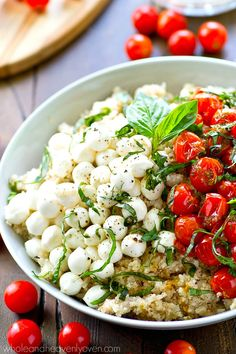Juicy herb-roasted cherry tomatoes and tons of other caprese goodness star in this secretly-healthy cauliflower rice caprese salad.---This easy summer salad is SO good with grilled chicken or fish!