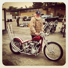 Red and chrome knucklehead chopper with tall sissy bar and upswept exhaust