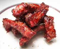 "Everybody loves Chinese restaurant ""BBQ"" ribs. Here's a simple recipe for making them at home on your grill or in the oven. The secret is not in the sauce but in the marinade."