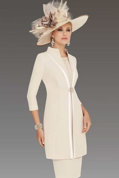 This knee length dress features a pearl design on the bodice and a capped sleeve. The matching coat has a contrasting trim and fastens with a diamante clip. Colour: Almond-ivory