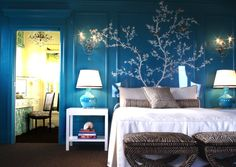 Kendall Wilkinson Design: Gorgeous turquoise bedroom with orange accents. The traditional style paneled walls with a tree painted on the wall. I love these.
