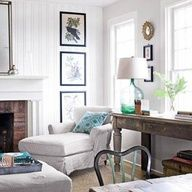 Beautiful white living aread...love the blue bottle lamp