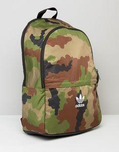b71ef2c570c3 adidas Originals Camo Print Backpack With Trefoil Logo at asos.com