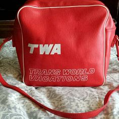 Vintage TWA Airline Stewardess Carryon bag 1970's Made of red vinyl and white piping this bag has one pocket on the outside. It is zippered to close with 4 feet. 11.5 x 12 x 4.5. There are some marks on the outside where my hand is. I do not know if the will come out. I am afraid to try. Very hard to find TWA Bags Satchels
