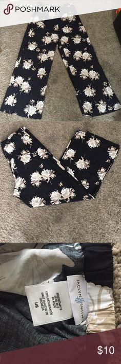 Floral print black & cream palazzo pants Floral print black with cream and ran flowers palazzo pants. Gently worn. Elastic band in the back only with zipper on the side. Size: large but are very big. Jaclyn Smith Pants Wide Leg