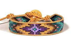 Bead loom leather wrap bracelet purple teal turquoise sky eye This is a loom made leather wrap bracelet made with natural undyed leather cord from the USA and 11/0 Delica Japanese seed beads in an exciting range of colors from deep purple violet to vibrant turquoise. The button is undyed