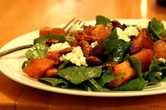Spinch salad with roasted sweet potatoes, goat cheese and candied nuts (options to add: broccoli, chicken, apples)