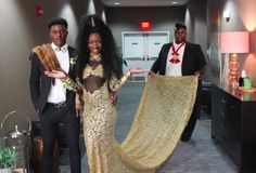 "These teens took prom to a whole new level. This is Autumn from Michigan in her Coming to America-inspired prom dress. Here she is accompanied by Prince Akeem and Oha. | This Teen Designed An Amazing Handmade ""Coming To America"" Prom Dress"