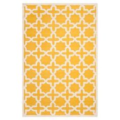 Wool rug with a trellis motif. Hand-tufted in India.   Product: RugConstruction Material: WoolColor: Gold and ivoryFeatures:  Made in IndiaHand-tufted Dimensions: 5' x 8'Note: Please be aware that actual colors may vary from those shown on your screen. Accent rugs may also not show the entire pattern that the corresponding area rugs have.Cleaning and Care: Professional cleaning recommended