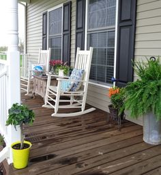 #rockingchair + thrifted table that provides storage for plant fertilizer, candles, bug spray, & extra flower pots on #porch