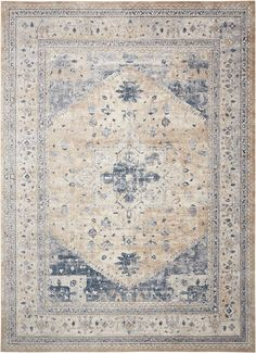 With its striking central motif and spectacular geometric botanical designs in gilded shades of beige, gold, blue and ivory, this magnificent rug is completely captivating. Marvelously washed to simulate the look and feel of a priceless antique, our...