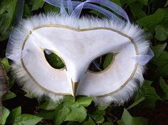 This is a simple handmade leather owl mask trimmed in rabbit fur. This would work well for any number of fantasy, Renaissance, Live Action, or