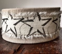 Tan desert camouflage bracelet made from donated Navy uniform with stars print. Benefits military nonprofit by ValorBands on Etsy