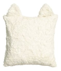 H&M US Cushion cover in soft faux fur with attached ears at top, woven cotton backing, and concealed zip. Size 16 x 16 in. DETAILS 78% modacrylic, 22% polyester. Machine wash cold Imported Art.No. 31-4158  $18 - http://www.hm.com/us/product/28627?article=28627-B