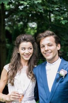 Louis Tomlinson And Eleanor Calder Blissful Sip Champagne Together At Jay And Dan's Wedding In July - http://oceanup.com/2014/11/24/louis-tomlinson-and-eleanor-calder-blissful-sip-champagne-together-at-jay-and-dans-wedding-in-july/
