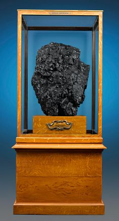 Museum Sample of Monumental Italian Coal. A truly monumental treasure of the natural world, this rare coal sample is one of the largest ever to be unearthed. The impressive 300 million year old specimen comes from the renowned Italian mine, Ribolla, a name that evokes the rich history of the Italian mining industry that has flourished for over a century. This and more rare mineral specimens for sale on CuratorsEye.com
