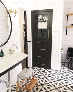 Black and white bathroom/ cement tiles kohler brockway sink Farmhouse bathroom. Shiplap. around bathroom mirror