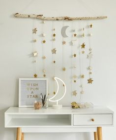 Create your own dreamy room decor with a DIY star wall hanging - Think. : Create a DIY star wall hanging using a tree branch, twine, and paper stars. Add glitter or wrapping paper for dreamy room decor. Cute Room Decor, Diy Wall Decor, Bedroom Decor, Home Decor, Diy Crafts Room Decor, Diy Wand, Star Wall, Paper Stars, Aesthetic Room Decor