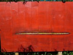 The large painting. The color red is inspired by the Flemish primitive painters who used red to emphasize important items and persons.