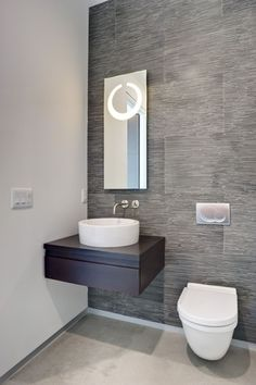 Contemporary Powder Room with Flush, Powder room, Toto Wall-Hung Toilet, Concrete floors, European Cabinets, Vessel sink