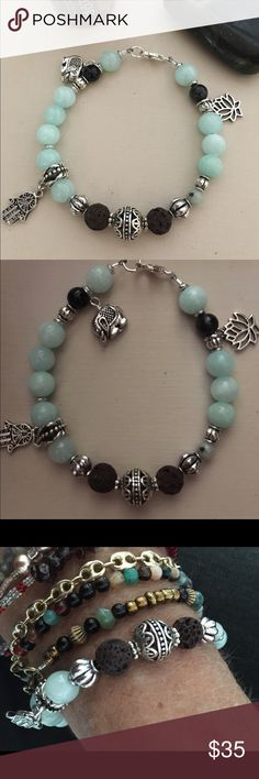 """Essential Oil Yoga Charm Bracelet  Artisan Handmade featuring Beautiful Amazonite , Black Tourmaline Gemstones ,with Brown Lava beads, Antique Carved Tibetan Silver Focal and spacer beads. Hamsa Hand, Lotus, Elephant Charms. This has a Large Sterling Silver Lobster Clasp and Includes Sample Essential Oil ( put drop on Lava Stone)7 3/4""""  Custom Size Available Jewelry Bracelets"""