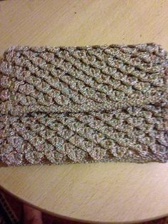 Rectangular lurex crocheted clutch bag made in crocodile stitch giving a lovely texture to the finished article. Fully lined with inner