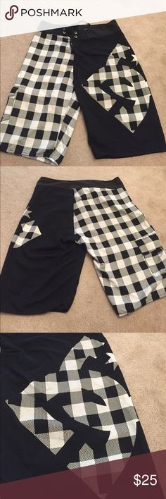 Men's DC Checkered Board Shorts - 32W 100% Polyester black and white colored board shorts by DC. No rips, stains, or tears. DC Swim Board Shorts