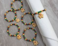 DianaSianCrafts shared a new photo on Etsy Holiday Crafts, Christmas Gifts, Christmas Decorations, Christmas Time, Christmas Napkin Rings, Beaded Napkin Rings, Wine Glass Charms, Organza Gift Bags, Winter Theme