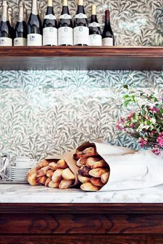 Petit Trois Los Angeles restaurant tour // Fresh baguettes and floral wall.
