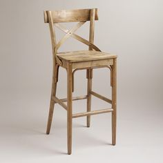 "Authentic and affordable, our vintage-inspired French Bistro Barstool is reminiscent of one you'd find in a Parisian patisserie. Crafted of distressed hardwood, it features swooping ""X"" detailing and a wide, flat seat."