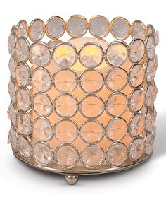 (5) Clear Indoor/Outdoor Lighted LED Candle. Crystal Beaded Candleholders $12 ea. Includes candle and holder Holder: 4'' H x 4.13'' diameter Candle: 3'' H x 3'' diameter Five hour timer Requires three AAA batteries