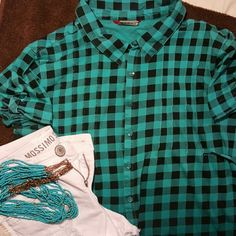 Union Bay flannel, black/turquoise  jrsz lg Cute tie in the back, button on sleeves. Looks cute w skinny jeans/leggings and boots, or w shorts for summer. No stains or tears, no missing buttons. This is a junior size lg not womans Unionbay Tops Button Down Shirts