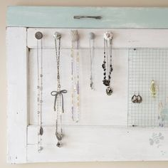 Made from an old screen door and some pretty knobs I picked up. A great way to display and organize my favorite jewelry!