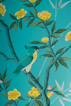 Diane Hill hand painted interiors turquoise chinoiserie mural. Colourful nursery (or children's bedroom) inspired by 18th century silk wallpaper. Create a stunning interior design for your home decor, or a feature wall.  This design detail features a chinoiserie parrot nestled in a tree amongst yellow chinoiserie flowers.