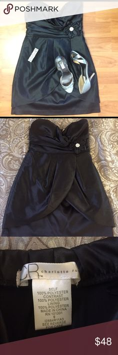 Black strapless dress This little black dress is strapless with a black straight slip underneath and a curved overlay. Sweetheart neckline. There is a fabric flower on the left side with a jeweled center. The top has a soft feel while the skirt of the dress has a linen feel. Worn once in Vegas for my 21st pictured above. Complete your outfit with shoes and bracelet shown in pic also for sale in my closet. Bundle for a deal. Make an offer! Charlotte Russe Dresses