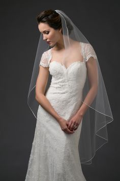 "Waltz length Toni Federici veil with a ribbon edge.  ""VOW"""