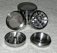"""Four Piece Herb, Spice or Tobacco Pollen Grinder, 42 mm diameter (1.65"""") by Gator Crunch. $7.99. Extra Fine Mesh Screen. Magnetic closure. 1.625"""" wide. 1 1/2"""" tall. Weight 2.6 oz... Nylon """"O"""" ring on bottom grinding section rim. NO more scratchy noise when in use!. 12 teeth in top section. 10 teeth in bottom section. 21 holes.. This item is made of super strong aircraft grade aluminum. Excellent and smooth grinding guaranteed. teeth are razor sharp. the screens are very tigh..."""