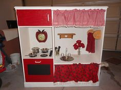 Make a kids kitchen from an old tv stand.....