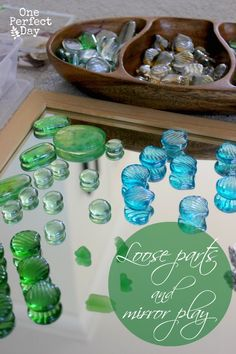 Reggio inspired play - exploring mirrors and loose parts.