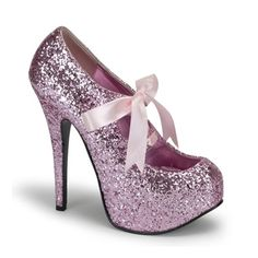 I don't know when it happened, but between the time I left the traveling show and the time I started the MRI program, I developed a taste for shoes and the color pink. My inner 5 year-old is throwing a tantrum over these.