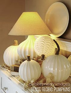 Pumpkins made from glass light domes via HOMEward Found Decor and @Debi Gardner-Faver Ward Kennedy